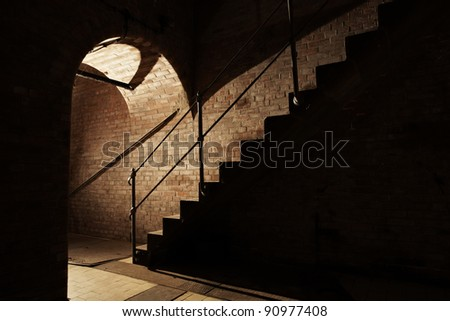 Stairs and underground corridor in old industrial building. - stock photo