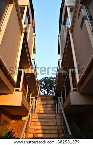 Stairs between a set of terraced apartments. - stock photo