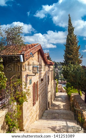 Stairs goes down on the silent Jerusalem lane - stock photo