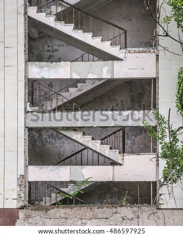 stairs in abandoned house with ruined wall in Pripyat