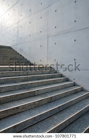 Stairs in front of a wall - stock photo
