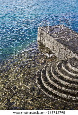 Stairs in Playa Blanca beach in Lanzarote, Canary Islands (Spain - stock photo
