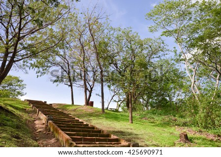 Stairs in the park within Leon Viejo - ruins of the old city of Leon, Nicaragua. The city was abandoned after the quake and Momotombo eruption in the 17th century. Unesco world heritage site - stock photo