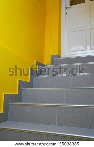 Stairs leading to a closed door