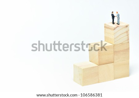 Stairs of square blocks and Businessman. (on white background) - stock photo