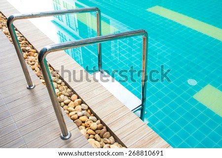 Stairs of the empty swimming pool - stock photo