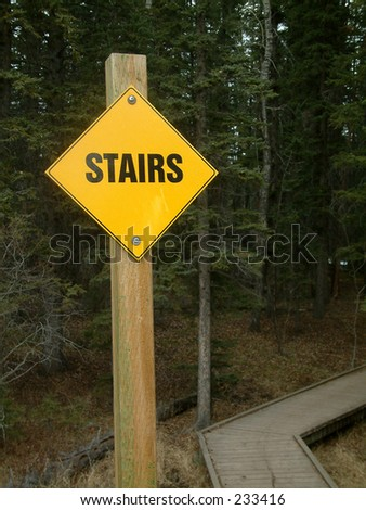 stairs sign in the forest.