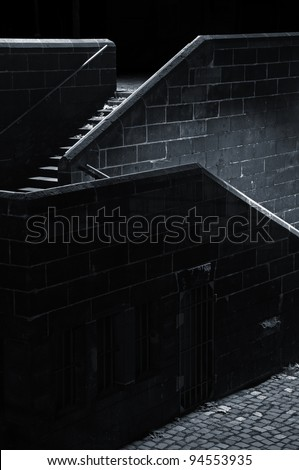 Stairs Stairs in the darkness lighted by an invisible source of light - stock photo