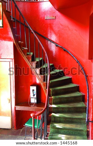 Stairs to Bathroom, Pat O'Briens, New Orleans, LA - stock photo