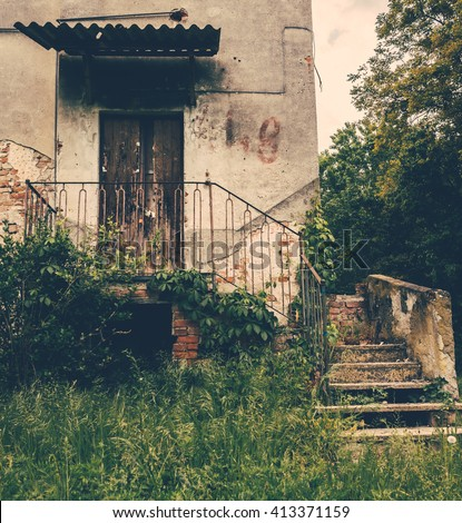 Stairs to old abandoned house in the woods - stock photo