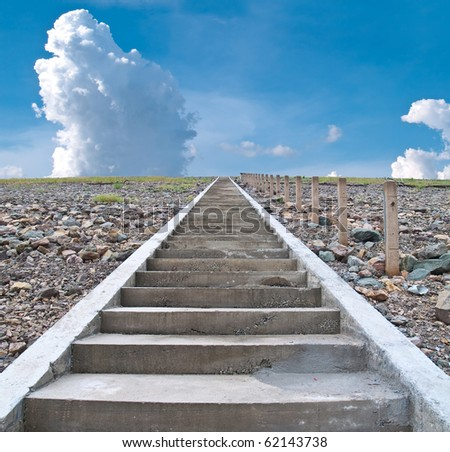 Stairs to paradise with white fluffy clouds and blue sky - stock photo
