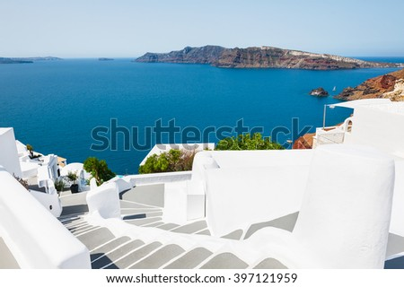 Stairs to the sea. White architecture on Santorini island, Greece. Beautiful landscape with sea view.