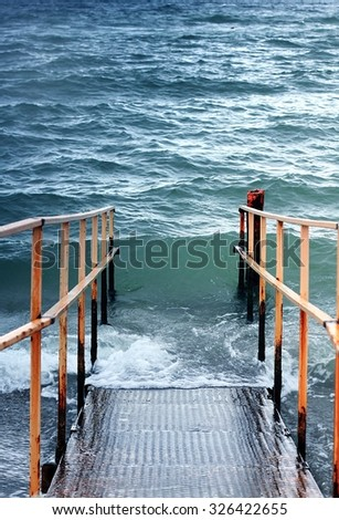 Stairs to water for handicapped people