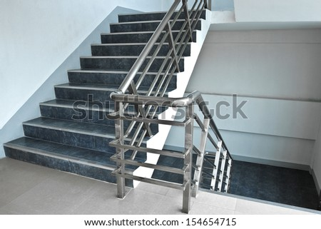 Stairs up and down between floors. - stock photo