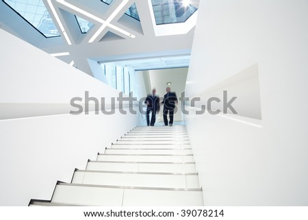 stairs up with two business men comming down - stock photo