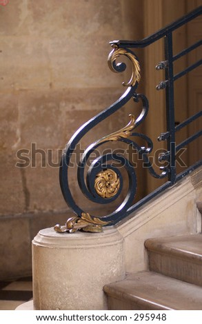 Stairs with a metal girl of a building in Paris, France, - stock photo