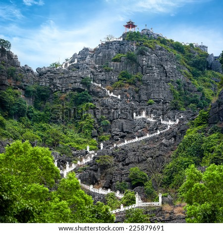 Stairway at limestone mountain to Hang Mua view point. Popular tourist attraction at Tam Coc, Ninh Binh. Vietnam travel landscapes and destinations