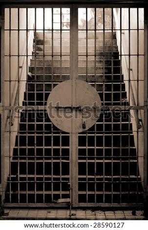 stairway behind the locked gate - stock photo
