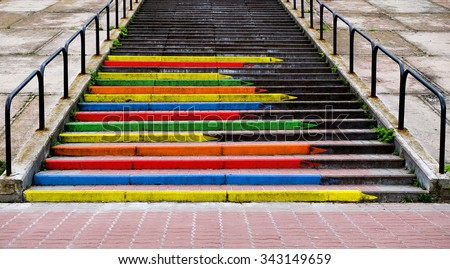 Stairway concept  in the form of pencils of rainbow colors contrasted photo - stock photo