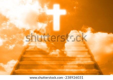 stairway going up to the christian cross door,orange color tone - stock photo