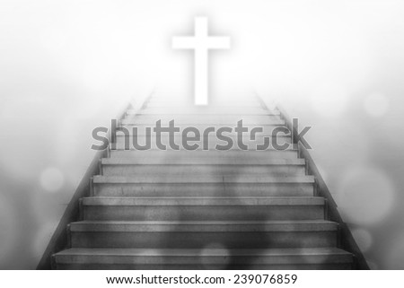 stairway going up to the christian cross with bokeh light background,gray color tone - stock photo