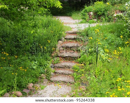 Stairway in an ecological garden in spring - stock photo