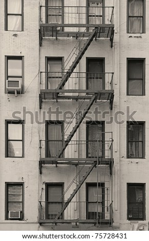 Stairway outside of old building in New York City Manhattan apartment in black and white. - stock photo