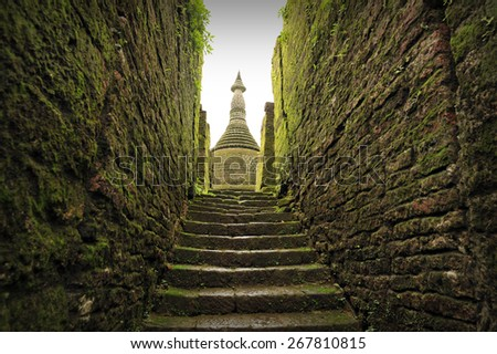 Stairway to Buddhist sanctuary of Koetaung, the temple of the 90,000 Buddhas, built by King Min Dikkha during the years 1554-1556 in Mrauk U, Rakhin State in Myanmar. - stock photo