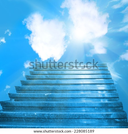 Stairway to heaven. Stairs towards sun on the blue sky with clouds - stock photo