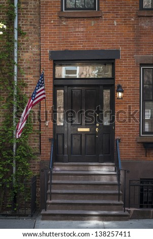 Stairway with an American flag by an old apartment, New York City - stock photo