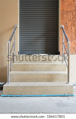 stairway with rail in front of the door