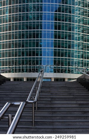 Stairway with steel  handrails lead up to entrance of office building. - stock photo