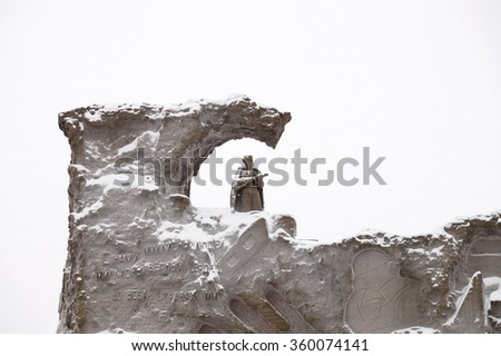 """Stalingrad: an inscription on the Mamayev Kurgan bas-relief """"With us millions of people, millions of stout hearts worldwide!"""" - stock photo"""