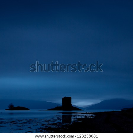 Stalker castle at the Scottish west coast in the dim light of dawn - stock photo