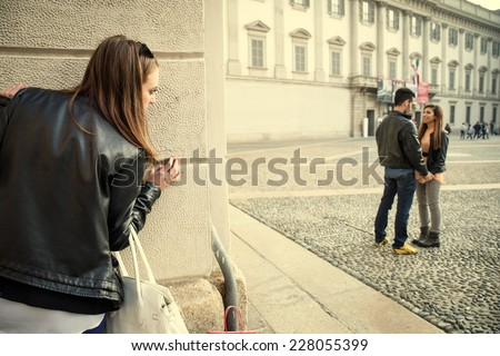 Stalking - Ex girlfriend spying her ex boyfriend with another woman - stalking,infidelity and jealousy concepts - stock photo