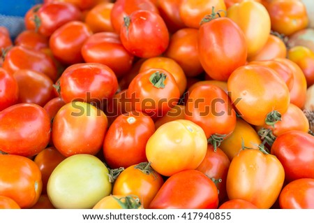 stall of tomatoes at the market