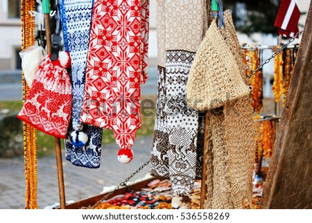 Stalls with knitted goods on the street of Riga