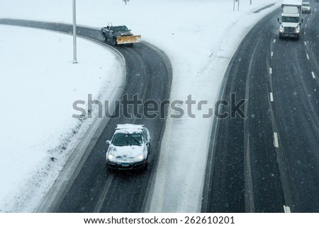 Stamford, CT - March 5: Daytime traffic on the interstate highway on March 5, 2015 in Stamford Connecticut during a snow storm.  - stock photo