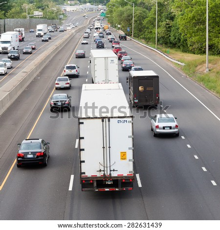 Stamford, CT - May 29, 2015: Daytime traffic on the interstate highway on May 29, 2015 in Stamford Connecticut  - stock photo