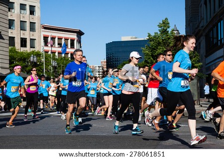 Stamford, CT, USA - June 1, 2014: The individuals are some of the many runners for the cancer awarness marathon in Stamford, CT, June 1, 2014,