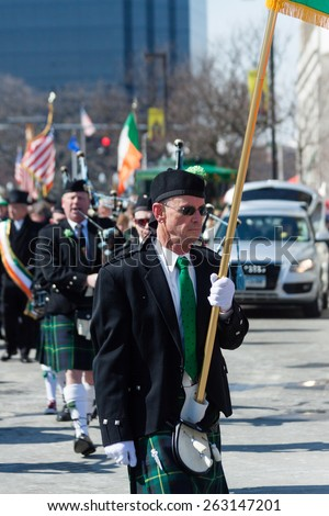 "Stamford, USA - March 7, 2015: The individuals are some of the many people participating in the annual ""St. Patrick's Day"" parade in downtown Stamford on March 7, 2015"