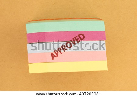 Stamp approved on blue post it note