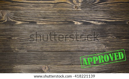 Stamp approved on wooden background