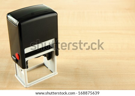 Stamp on wooden background - stock photo