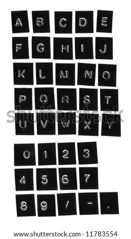 stamped alphabets and numbers on a white background - stock photo