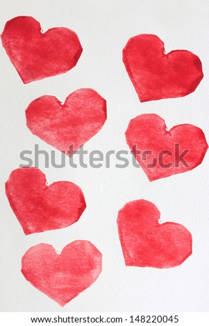 stamped hearts on paper - stock photo