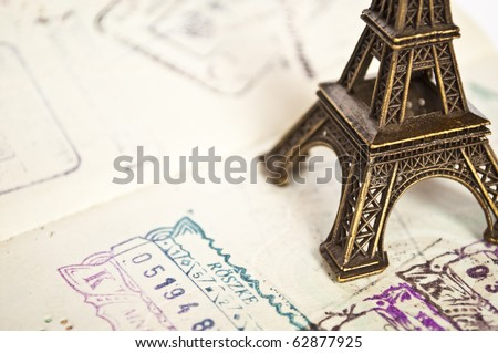 Stamped passport with Eiffel passport - travel to Paris concept - - stock photo