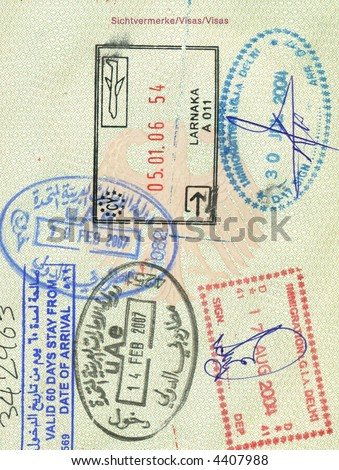 stamps of cyprus, india and uae in german passport - stock photo
