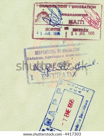 stamps of republic of dominicania and haiti in german passport - stock photo