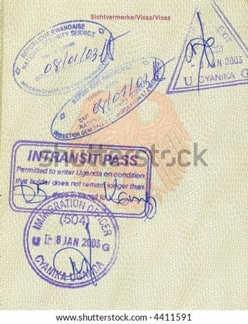 stamps of rwanda and uganda in german passport - stock photo
